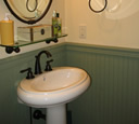 Kohler Revival pedestal sink with oil-rubbed bronze faucet finish.